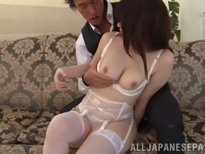 Leaving on her sexy white lingerie as she gets fucked