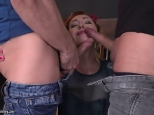 Hot redhead surrounded by dudes who want to bang her at the same time