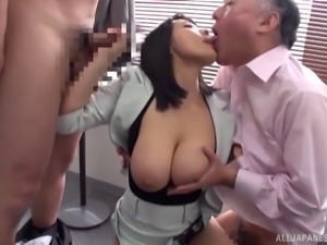 Busty office worker cannot resist playing with horny men's dicks