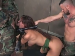 Busty redhead Syren De Mer is getting spitroasted by two horny masters