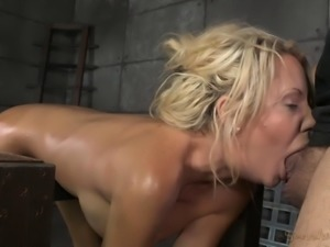 Chick with fake boobs bends over for a master's hard prick