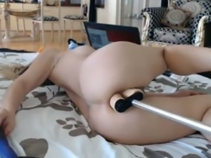 Tempestuous girl masturbating with two sex machines in kinky video