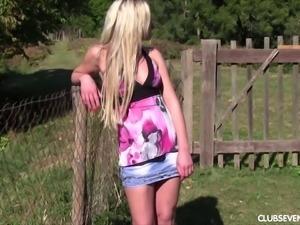 Slim blonde teen fingering wet vagina on a lawn outdoor