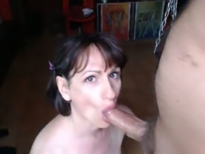 Brunette girl sucking hard cock balls deep in amateur video