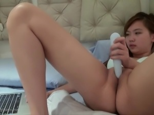 Naughty Harriet masturbates with a toy while watching a movie