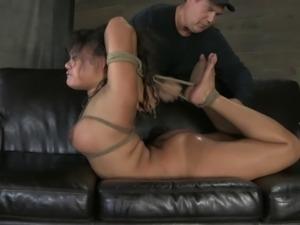 Big tits bondage model getting face fucked in BDSM