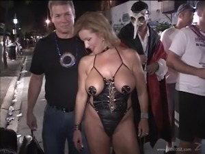 Sexy blonde milf wearing glasses shows her tits at a party