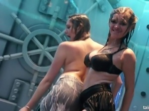 Horny ladies dance in their clothes while getting dripping wet