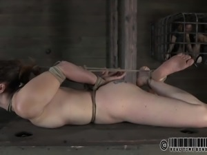 Bondage slave screaming when her tits gets pegged in BDSM
