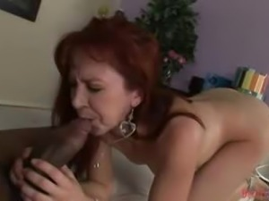 Incredibly Hot Redhead Milf Takes A Monster Black Cock Up Her Tight Butthole