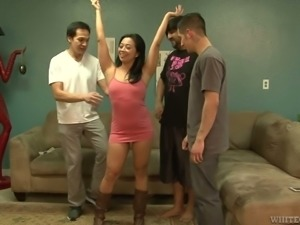 Dirty and submissive brunette girl gets on her knees to feed on dicks