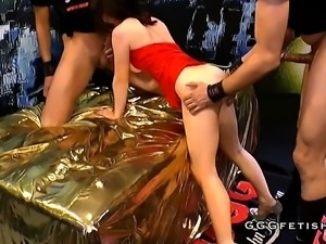 Brunette in red gets gangbang and bukkakes