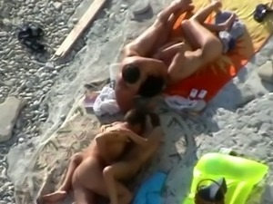 Spying on two friends fucking their bitches on the beach