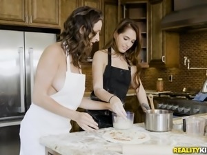 Things are hotting up in the kitchen tonight! Beautiful brunette babes take a...