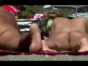 Nudist beach voyeur vid with gorgeous brunette all naked