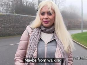 Blonde gets cock between big tits in public