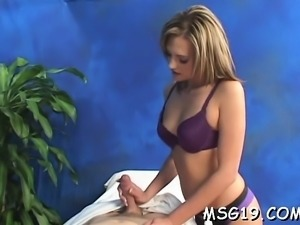 Girl acquires fucked on a massage table enjoys a facial load