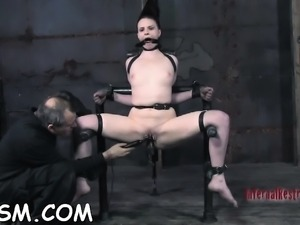 Gagged beauty is hoisted up previous to hard snatch prodding