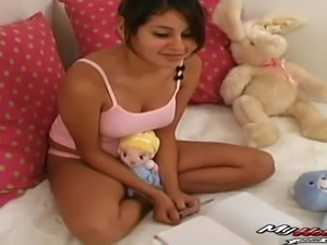 Little Lexis is a big titted Latin schoolgirl whos on her bed, wearing