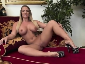 Blonde in stockings receives a black shaft