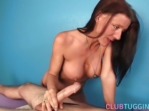 Busty ginger granny jerking and tugging cock