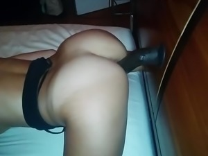 Cums hard with mounted black dildo