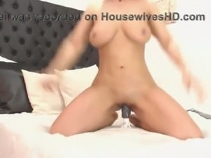 Adorable and thick webcam girl with big juicy tits is riding her dildo