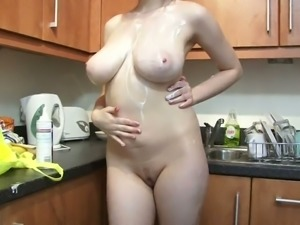Cute and playful girl having fun in a kitchen