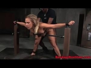 Restrained sub with big tits gets spitroasted