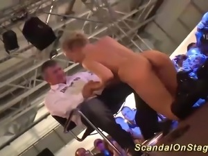hot busty blonde babe give a extreme wild lapdance on public sex fair show stage