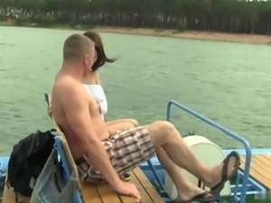Boobed Rita is fucked on the water with her new boyfriend