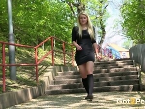 Hot sassy blondie in black dress urinating on the stairs