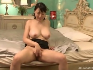 Asian woman with big tits wants to make a cock hard