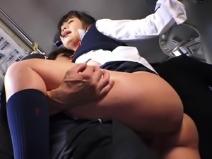 Kissing his Japanese schoolgirl and smacking her throbbing pussy