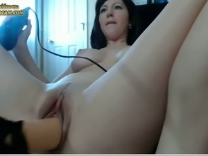 This MILF loves to use her sex machine and she's got a nice spankable ass