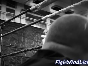 Lesbian beauties wrestling in a boxing ring