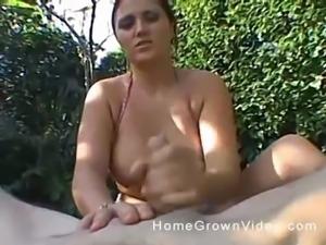 Busty babe makes a stranger's cock hard on a beach