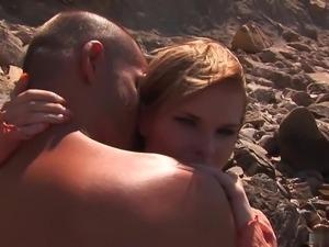 Tarra licks up all cum on the beach