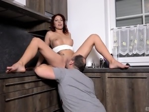 Cutie Natalie Hot gets her knees dirty and sucks a tasty schlong