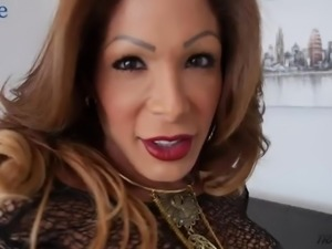 Amazing shemale Vanessa Jhons plays with her tits and cock on cam