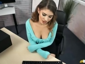 Seductive secretary Katie Louise exposes her nice juicy titties