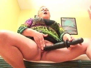 Moans as mature granny blast her pussy using massive toy