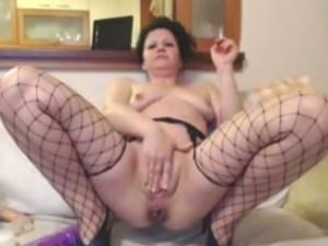 Filthy ass bitch in fishnet stockings anal masturbating on webcam session...