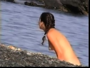 French amateur girl blows on a public beach