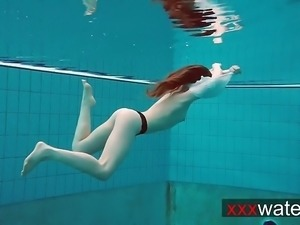 Pierced teen swimming