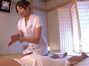 Sexy as hell Japanese brunette gives dude an oily massage