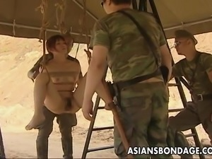 Soldiers take turns fucking a tied up Japanese girl