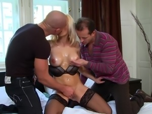 Stacy Silver enjoys a double penetration with a couple of fellows