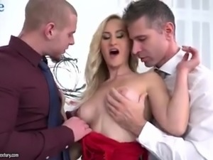 This blondie is hungry for cock and she needs two cocks to satisfy her needs