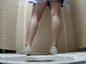 Sweet and sexy white girl in dress urinates in the toilet and gets filmed on...